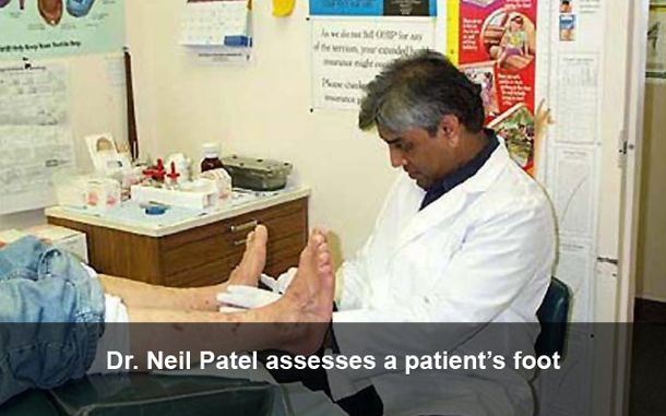 Dr. Neil Patel assesses a patient's foot